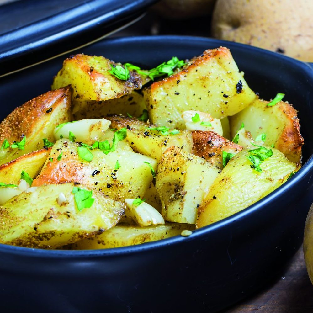 Baked potato, roasted potatoes with rosemary. Selective focus